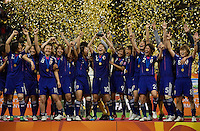 Japanese captain Homare Sawa (10) raises the trophy and celebrates with her teammates following the final of the FIFA Women's World Cup at FIFA Women's World Cup Stadium in Frankfurt Germany.  Japan won the FIFA Women's World Cup on penalty kicks after tying the United States, 2-2, in extra time.