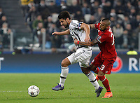Calcio, andata degli ottavi di finale di Champions League: Juventus vs Bayern Monaco. Torino, Juventus Stadium, 23 febbraio 2016. <br /> Juventus' Sami Khedira, left, is challenged by Bayern's Arturo Vidal during the Champions League round of 16 first leg soccer match between Juventus and Bayern at Turin's Juventus Stadium, 23 February 2016.<br /> UPDATE IMAGES PRESS/Isabella Bonotto