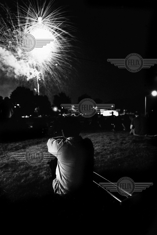 Myo Myint watches 4th July fireworks in Fort Wayne Indiana. At 16 Myo joined the army of the ruling Burmese junta, where he lost his right forearm and lower leg whilst laying a mine. The blast also took away his left eye and most of the fingers on his left hand. It was while recovering from his injuries in hospital that Myo Myint made the life altering and dangerous decision to change sides. He joined the new democratic opposition, a choice that would lead to a total of 15 years spent in prison. The documentary 'Burma Soldier' follows Myo Myint's journey from refugee camp on the Thai-Burma border to eventually being re-united with his siblings in the United States, chronicling his transformation from a soldier of Burma's junta to democracy activist; from a political prisoner to a refugee in a foreign land.
