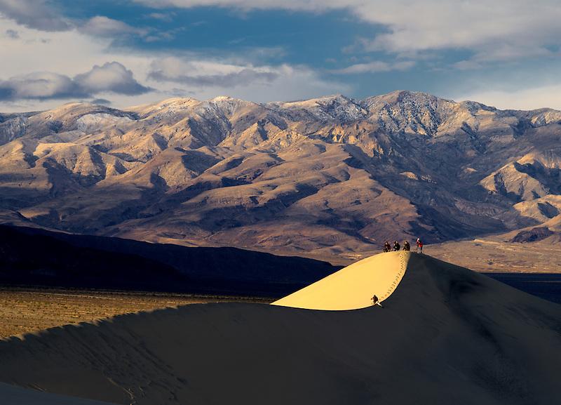Photographers on sand dunes. Death Valley National Park, California