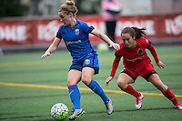 Seattle, Washington - Saturday May 14, 2016: Seattle Reign FC midfielder Kim Little (8) and Portland Thorns FC midfielder Meleana Shim (6) during the first half of a match at Memorial Stadium on Saturday May 14, 2016 in Seattle, Washington. The match ended in a 1-1 draw.