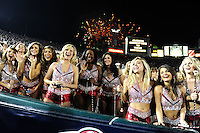 Jan 7, 2010; Pasadena, CA, USA; Alabama Crimson Tide dancers watch pregame warm-ups as fireworks explode over the Rose Bowl before the 2010 BCS national championship game between the Alabama Crimson Tide and the Texas Longhorns. Alabama won 37-21. Mandatory Credit: Mark J. Rebilas-..