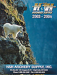 Nelson Kenter photo of a mountain goat on cliff side used on the cover of a hunting catalog