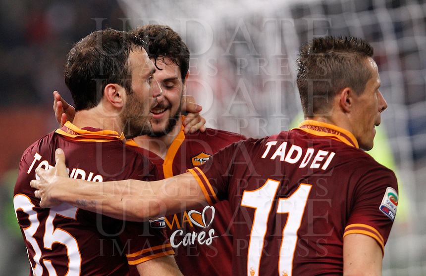 Calcio, Serie A: Roma vs Udinese. Roma, stadio Olimpico, 17 marzo 2014.<br /> AS Roma defender Vasilis Torosidis, of Greece, left, celebrates with teammates Mattia Destro, center, and Rodrigo Taddei , of Brazil, after scoring after scoring during the Italian Serie A football match between AS Roma and Udinese at Rome's Olympic stadium, 17 March 2014.<br /> UPDATE IMAGES PRESS/Riccardo De Luca