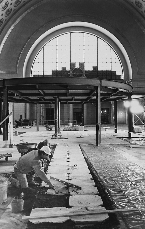 Construction workers doing floor work at Washington Union Station in March 1988. (Photo by Andrea Mohin/CQ Roll Call via Getty Images)