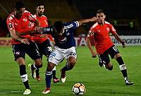 BOGOTÁ - COLOMBIA, 17-05-2018: Jhon Duque (Der.) jugador de Millonarios (COL), disputa el balón con Nicolás Figal (Izq.) jugador de Club Atlético Independiente (ARG), durante partido entre Millonarios (COL) y Club Atlético Independiente (ARG), de la fase de grupos, grupo G, fecha 5 de la Copa Conmebol Libertadores 2018, en el estadio Nemesio Camacho El Campin, de la ciudad de Bogota. / Jhon Duque (R) player of Millonarios (COL), figths for the ball with Nicolas Figal (L) player of Club Atlético Independiente (ARG), during a match between Millonarios (COL) and Club Atletico Independiente (ARG), of the group stage, group G, 5th date for the Conmebol Copa Libertadores 2018 in the Nemesio Camacho El Campin stadium in Bogota city. VizzorImage / Luis Ramirez / Staff.