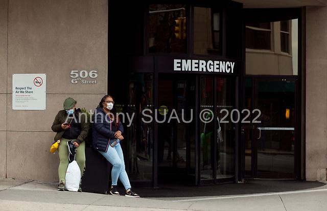 Brooklyn, New York<br /> March 20, 2020<br /> 1:52 PM<br /> <br /> Brooklyn under the coronavirus pandemic. <br /> <br /> People outside the emergency entrance to New York-Presbyterian Brooklyn Methodist Hospital in Park Slope, Brooklyn.