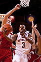 27 December 2011: Brandon Richardson #3 of the Nebraska Cornhuskers drives through Jared Berggren #40 and Ryan Evans #5 of the Wisconsin Badgers during the first half at the Devaney Sports Center in Lincoln, Nebraska. Wisconsin defeated Nebraska 64 to 40.