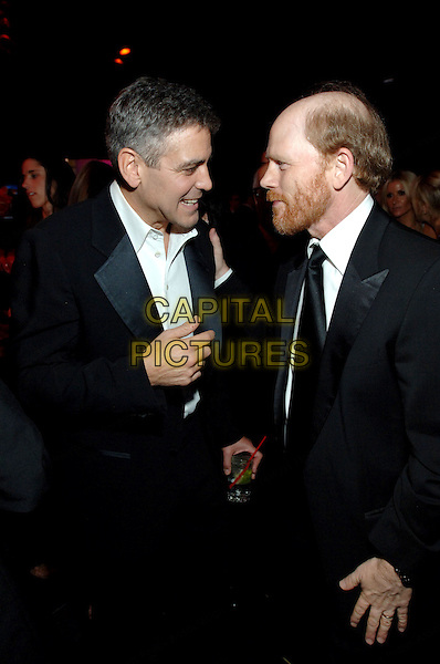 "GEORGE CLOONEY & RON HOWARD.The Weinstein Co. Golden Globe after party held at Trader Vic's in Beverly Hills, California, USA..January 16th, 2007. .globes half length black suit jacket beard facial hair profile drink beverage.CAP/AW.Please use accompanying story.Supplied by Capital Pictures.© HFPA"" and ""63rd Golden Globe Awards"""