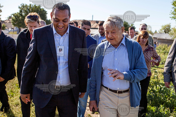 George Soros, chairman and founder of the Open Society Foundation, with Cristian Buceanu, a Roma council member elected, in 2012, with the support of residents of Frumusani.