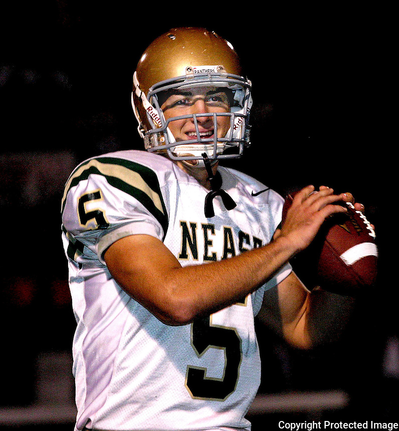 11/26/04.....Gary Wilcox/staff....... Nease High School QB Tim Tebow (5) warms up before  the class 3A championship game at St. Augustine High School last Friday night. Nease lost 35-28.
