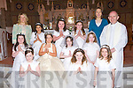 Girls from Castleisland Presentation who received their First Holy Communion in St Stephens and St Johns Church, Castleisland, on Saturday were Saoirse McCarthy, Shauna Prendergast, Amber Hayes, Alex Sheehan, Abbie Simonds, Clodagh Swanser, Ann Marie Kerins, Katsjana Siwak, Katie O'Connor and Grainne Spillane pictured here with teacher Evelyn O'Donoghue, principal Leona Twiss and Fr Michael Moynihan.