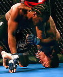 Anthony Lapsley, left, and Drew Fickett fight during a mixed martial arts bout in Dallas on Saturday, October 13, 2007.  Fickett won the bout.   (photo by Khampha Bouaphanh