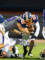 Rogers Heritage running back JJ Webb (25) gets hit at the line of scrimage by Fayetteville Quade Mosier (1) at Hank Gibbs passes the ball at Gates Stadium, Rogers, AR on November 1, 2019 / Special to NWA Democrat Gazette David Beach