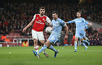 Leeds United's Jack Harrison and Arsenal's Sokratis Papastathopoulos<br /> <br /> Photographer Rob Newell/CameraSport<br /> <br /> Emirates FA Cup Third Round - Arsenal v Leeds United - Monday 6th January 2020 - The Emirates Stadium - London<br />  <br /> World Copyright © 2020 CameraSport. All rights reserved. 43 Linden Ave. Countesthorpe. Leicester. England. LE8 5PG - Tel: +44 (0) 116 277 4147 - admin@camerasport.com - www.camerasport.com