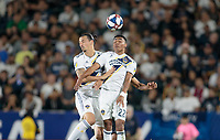 CARSON, CA - JULY 19: Zlatan Ibrahimovic #9 and Julian Araujo #22 of the Los Angeles Galaxy get after an air ball during a game between Los Angeles FC and Los Angeles Galaxy at Dignity Health Sports Park on July 19, 2019 in Carson, California.