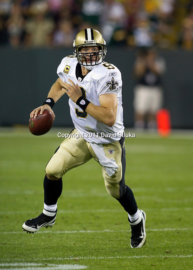 New Orleans Saints quarterback Drew Brees (9) scrambles out of the pocket during a Week 1 NFL football game against the Green Bay Packers on September 9, 2011 in Green Bay, Wisconsin. The Packers won 42-34. (AP Photo/David Stluka)