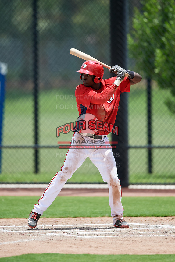 GCL Nationals center fielder Caldioli Sanfler (9) at bat during a game against the GCL Mets on August 4, 2018 at FITTEAM Ballpark of the Palm Beaches in West Palm Beach, Florida.  GCL Nationals defeated GCL Mets 7-4.  (Mike Janes/Four Seam Images)