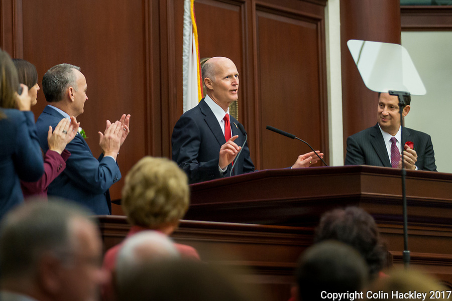 TALLAHASSEE, FLA. 3/7/17-Gov. Rick Scott, center, receives applause from Speaker Pro Tempore Jeanette Nunez, R-Miami, left, House Speaker Richard Corcoran, R-Land O'Lakes, and Senate President Joe Negron, R-Stuart, right as he begins his State of the State address during opening day of the legislative session at the Capitol in Tallahassee.<br /> <br /> COLIN HACKLEY PHOTO