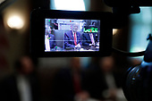 United States President Donald J. Trump is seen on tv monitor during a Cabinet Meeting at the White House in Washington, DC on October 21, 2019.<br /> Credit: Yuri Gripas / Pool via CNP