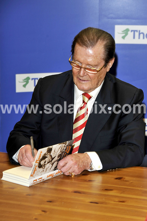 **ALL ROUND PICTURES FROM SOLARPIX.COM**.**SYNDICATION RIGHTS FOR UK AND SPAIN ONLY**.Roger Moore, with his wife Christina Tholstrup, signs autographs at Thalia Book Store in Hamburg, Germany. 30 May 2009..This pic: Roger Moore..JOB REF: 9130  CPR (Bug)   DATE: 30_05_2009.**MUST CREDIT SOLARPIX.COM OR DOUBLE FEE WILL BE CHARGED**.**ONLINE USAGE FEE GBP 50.00 PER PICTURE - NOTIFICATION OF USAGE TO PHOTO @ SOLARPIX.COM**.**CALL SOLARPIX : +34 952 811 768 or LOW RATE FROM UK 0844 617 7637**