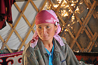 Portrait of  young  kazaky nomad woman in her yurta