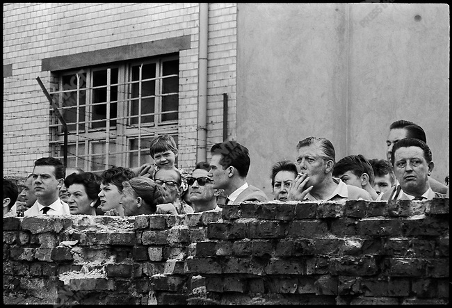 East Berliners watch construction of the Berlin Wall, viewed from the West Berlin side, Germany, August 1961