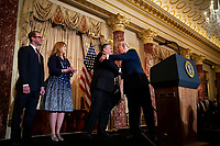 United States President Donald Trump greets Mike Pompeo, U.S. secretary of state, before he is sworn in, at the State Department, in Washington, D.C., U.S., on Wednesday, May 2, 2018. Next to Pompeo is his wife, Susan Pompeo, and son, Nick Pompeo. <br /> Credit: Al Drago / Pool via CNP /MediaPunch