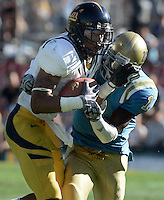 LOS ANGELES,CA - OCTOBER 9,2009: Cal's Marvin Jones gets wrapped up for an incomplete by UCLA's Alterraun Verner during 2nd half action. UCLA Bruins vs. California Golden Bears, in an NCAA Pac 10 football game at the Rose Bowl, Sat. Oct 17, 2009. Cal won 45-26..(Photo: Spencer Weiner/Los Angeles Times)