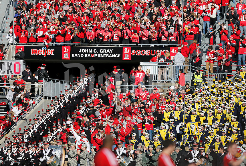 The Ohio State Marching band enters the stadium prior to the NCAA football game against Michigan at Ohio Stadium on Saturday, November 29, 2014. (Columbus Dispatch photo by Jonathan Quilter)