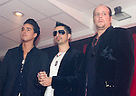 "Moenia pop music band members, Alejandro Ortega (L), Jorge Soto and Alfonso Pichardo (R) pose to photographers as they arrive at a press conference, March 28, 2006. Moenia received  a golden award after selling 50 thousand copies of their last CD ""Hits Live"". Photo by © Javier Rodriguez"