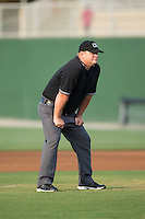 Umpire Kevin Morgan handles the calls on the bases during the South Atlantic League game between the Delmarva Shorebirds and the Kannapolis Intimidators at Kannapolis Intimidators Stadium on June 25, 2016 in Kannapolis, North Carolina.  The Intimidators defeated the Shorebirds 2-1.  (Brian Westerholt/Four Seam Images)