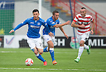 Hamilton Accies v St Johnstone...16.08.14  SPFL<br /> Michael O'Halloran takes the ball off Chris Millar<br /> Picture by Graeme Hart.<br /> Copyright Perthshire Picture Agency<br /> Tel: 01738 623350  Mobile: 07990 594431