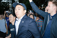 """Entrepreneur and Democratic presidential candidate Andrew Yang arrives to speak to a large crowd in Cambridge Common near Harvard Square in Cambridge, Massachusetts, on Mon., September 16, 2019. Yang's unlikely presidential bid is centered on his idea for a """"Freedom dividend,"""" which would give USD$1000 per month to every adult in the United States. After appearing in three Democratic party debates, Yang has risen in polls from longshot candidate to within the top 10."""