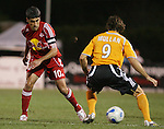 31 March 2007: New York's Claudio Reyna (10) defends against Houston's Brian Mullan (9).  Major League Soccer's Houston Dynamo defeated the New York Red Bulls 2-1 in a preseason game at Blackbaud Stadium on Daniel Island in Charleston, SC, as part of the Carolina Challenge Cup.