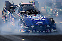 Aug 15, 2014; Brainerd, MN, USA; Smoke comes out the front of the car of NHRA funny car driver Robert Hight as he comes to a stop following his burnout during qualifying for the Lucas Oil Nationals at Brainerd International Raceway. Mandatory Credit: Mark J. Rebilas-USA TODAY Sports