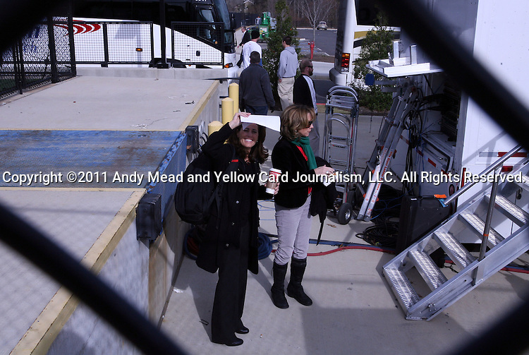 04 December 2011: ESPN broadcasters Julie Foudy (left) and Beth Mowins (right) outside the production truck before the game. The Stanford University Cardinal played the Duke University Blue Devils at KSU Soccer Stadium in Kennesaw, Georgia in the NCAA Division I Women's Soccer College Cup Final.