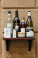 Wine and olive oil on outdoor shelf, Pienza, Italy, Tuscany