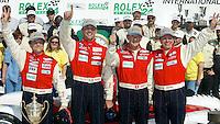 Mauro Baldi,  Max Papis, Fredy Lienhard and  Didier Theys celebrate in victory lane after winning the 24 Hours of Daytona, Daytona International Speedway, Daytona Beach, FL, February 3, 2002.  (Photo by Brian Cleary/www.bcpix.com)