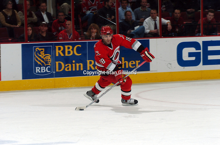 Carolina Hurricanes' Michael Zigomanis pass the puck during a game with the New York Rangers Thursday, Nov. 17, 2005 in Raleigh, NC. Carolina won 5-1.