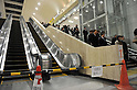 March 22, 2011, Kawasaki City, Kanagawa Prefecture, Japan - Commuters returning home by train use the stairs at Kawasaki Station near Tokyo as widespread energy conservation efforts alleviate pressure on Japan's power grid, heavily damaged in the 2011 Tohoku-Kanto Natural Disaster. (Photo by Atsushi Tomura/AFLO)