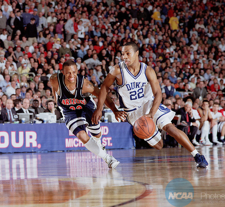 02 APR 2001:  University of Arizona guard Jason Gardner (22) and Duke guard Jason Williams (22) during the NCAA Men's National Basketball Final Four championship game held at the Hubert H. Humphery Metrodome in Minneapolis, MN. Duke defeated Arizona 82-72 for the title. Rich Clarkson/NCAA Photos