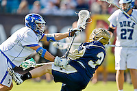 February 20, 2011:   Duke midfielder Jake Tripucka (7) knocks Notre Dame attack Nicholas Beattie (3) down with a hard hit during Lacrosse action between the Duke Blue Devils and Notre Dame Fighting Irish during the Moe's Southwest SunShine Classic played at EverBank Field in Jacksonville, Florida. Notre Dame defeated Duke 12-7.
