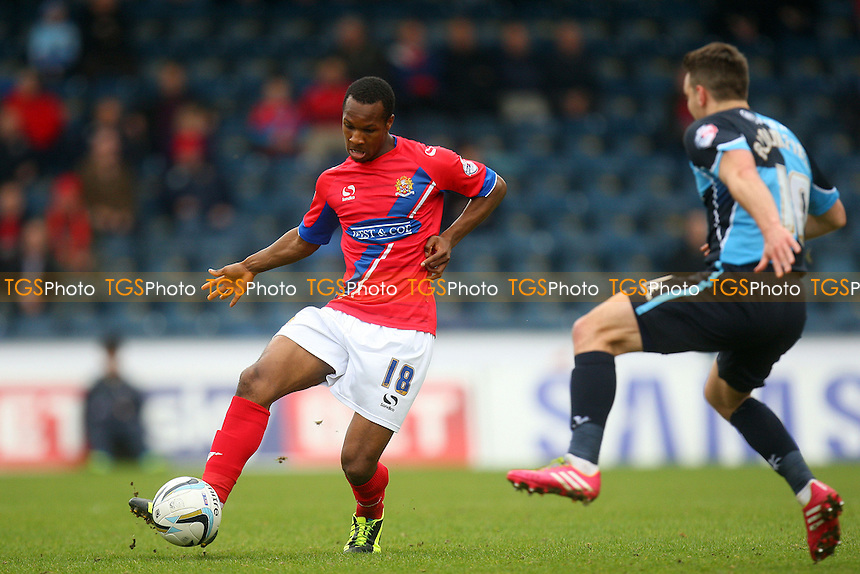 Gavin Hoyte of Dagenham and Redbridge and Matthew Bloomfield of Wycombe Wanderers - Wycombe Wanderers vs Dagenham and Redbridge, Sky Bet League Two Football at the Adams Park Stadium - 05/04/14 - MANDATORY CREDIT: Dave Simpson/TGSPHOTO - Self billing applies where appropriate - 0845 094 6026 - contact@tgsphoto.co.uk - NO UNPAID USE