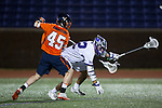 Asher Nolting (32) of the High Point Panthers is stick checked by Zach Ambrosino (45) of the Virginia Cavaliers during first half action at Vert Track, Soccer & Lacrosse Stadium on February 20, 2018 in High Point, North Carolina.  The Cavaliers defeated the Panthers 18-12.  (Brian Westerholt/Sports On Film)