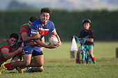 Luteru Laulala looks for support as he is taken to ground by Sam Cole and Gallipoli Misileki. Counties Manukau Premier Club Rugby game between Waiuku and Ardmore Marist, played at Waiuku on Saturday June 4th 2016. Ardmore Marist won 46 - 3 after leading 39 - 3 at Halftime. Photo by Richard Spranger.