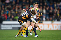 Errie Claassens of Worcester Warriors is tackled by Elliot Daly (left) and Chris Bell of London Wasps during the LV= Cup second round match between London Wasps and Worcester Warriors at Adams Park on Sunday 18th November 2012 (Photo by Rob Munro)