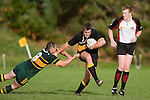M. Mckinnon fends off the K. Farrell tackle. Counties Manukau Premier club rugby game between Bombay & Pukekohe played at Bombay on the 19th of May 2007. Pukekohe led 24 - 0 at halftime & went on to win 30 - 22.