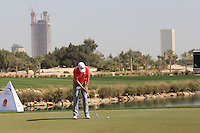 Peter Lawrie (IRL) putts on the 18th green during Friday's Round 3 of the Commercial Bank Qatar Masters 2013 at Doha Golf Club, Doha, Qatar 25th January 2013 .Photo Eoin Clarke/www.golffile.ie