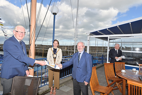 National YC Commodore Martin McCarthy presents 150th Raceday Flag to DMYC Commodore Frank Guilfoyle with DLR CoCo Caothaoirleach in attendance